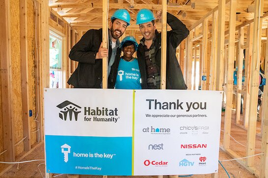 Drew and Jonathan Scott join future homeowner Krushetta to help build her house