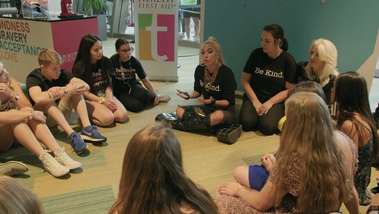 Lady Gaga with students from teen Mental Health First Aid program