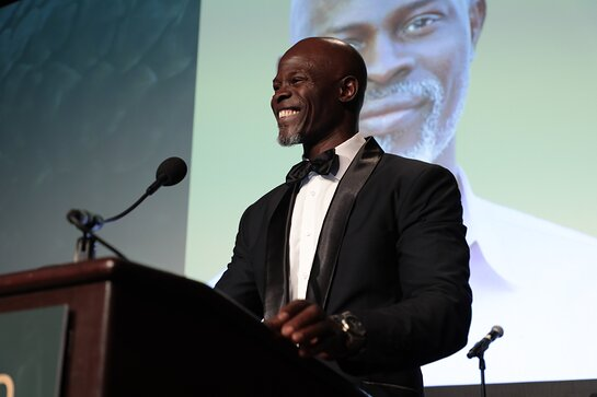 Djimon Hounsou speaks on stage at the WildAid Gala on November 9, 2019.