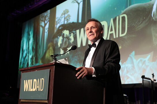 Peter Knights speaks on stage at the WildAid Gala on November 9, 2019.