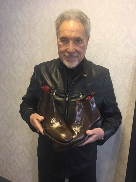 Sir Tom Jones will be donating once again this year with a gorgeous pair of leather Chelsea boots