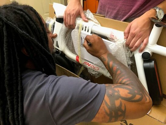 Lajon Witherspoon of Sevendust signs a SWAGTRON Swagcycle Pro.