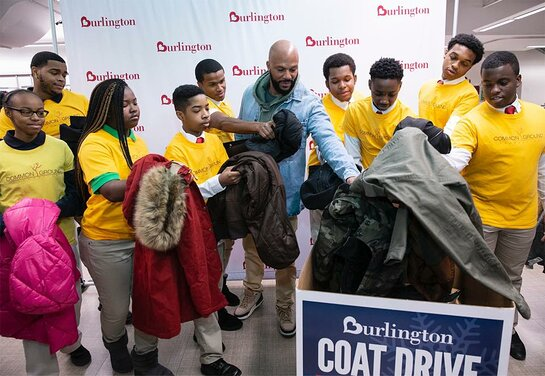 Common and local teens support the Burlington Coat Drive in Chicago.