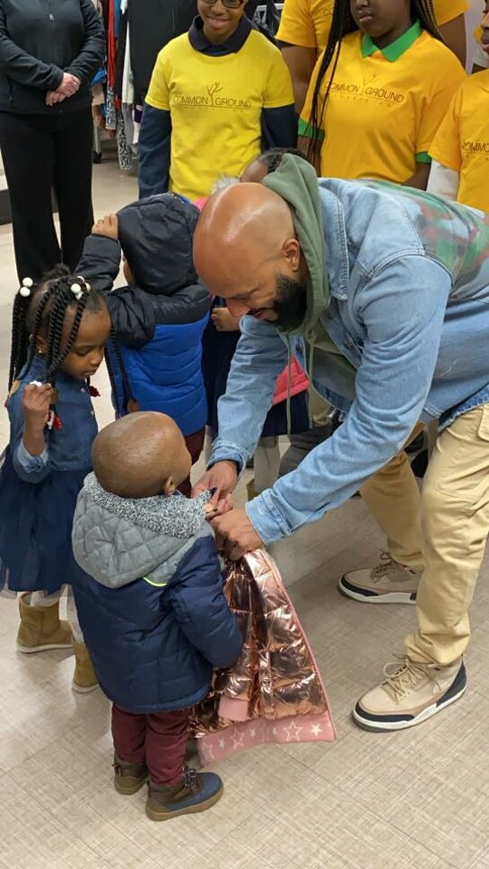 Common meets kids at the Burlington Coat Drive in Chicago.