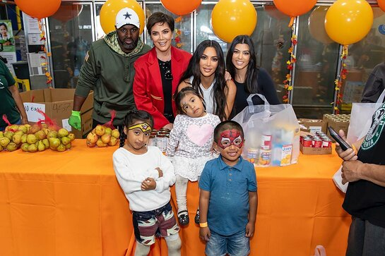 Kris Jenner, Kim Kardashian West, Kourtney Kardashian and Corey Gamble help out the Los Angeles Regional Food Bank.