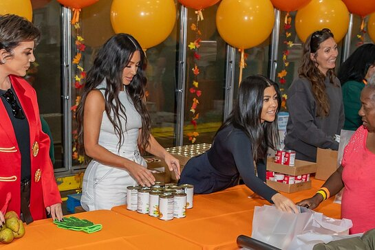 Kris Jenner, Kim Kardashian West, Kourtney Kardashian help out the Los Angeles Regional Food Bank.