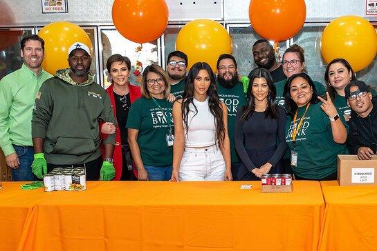 Kris Jenner, Kim Kardashian West, Kourtney Kardashian and Corey Gamble joined volunteers from the Los Angeles Regional Food Bank.