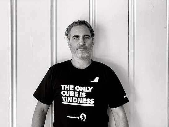 Joaquin Phoenix wearing a t-shirt bearing the words
