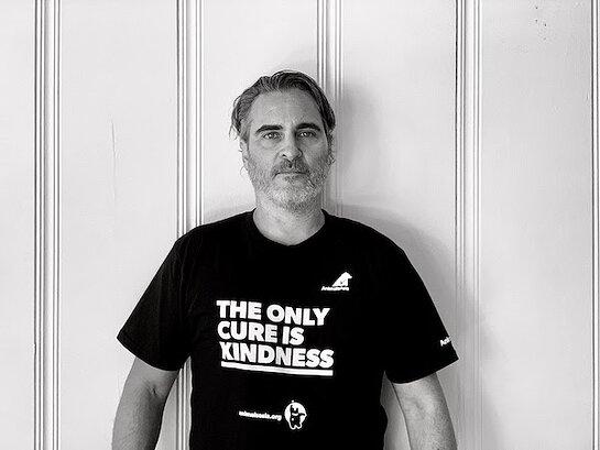 Joaquin Phoenix wearing a t-shirt bearing the words