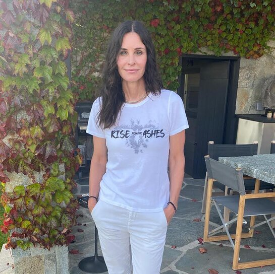 Courteney Cox in her #RiseFromTheAshes T-shirt