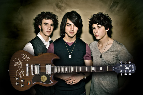 Jonas Brothers with auctioned Epiphone guitar