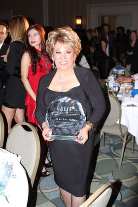 Lupe Ontiveros with NALIP Award