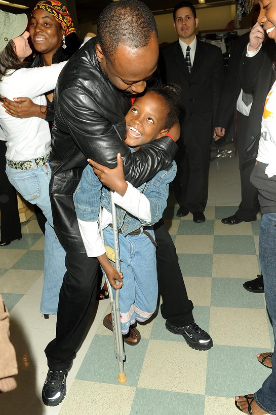 Wyclef Jean with Haitian Amputee at Kmart