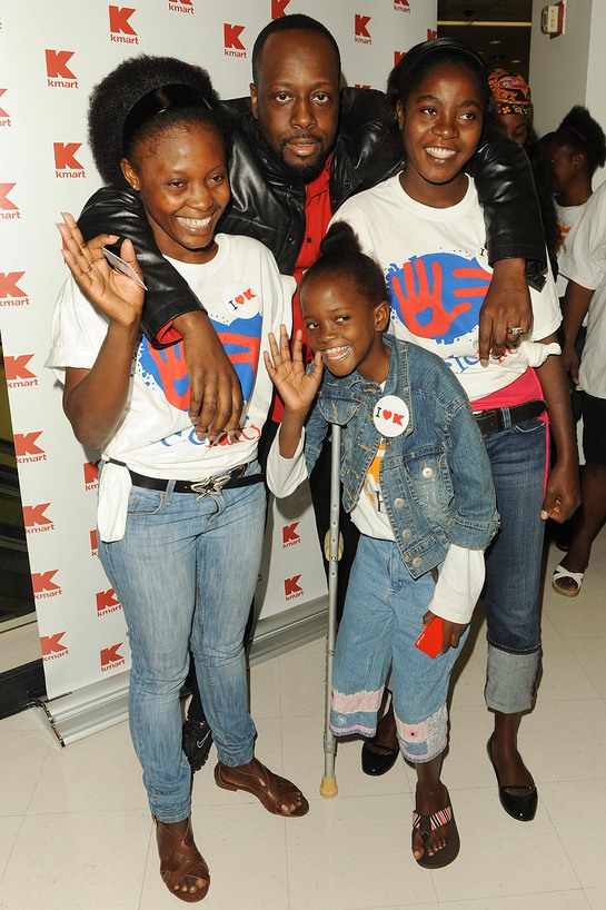 Wyclef Jean with Haitian Amputees at Kmart