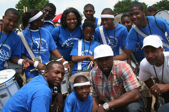 50 Cent with kids at Forever Young event