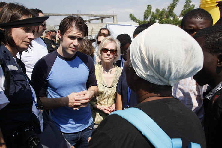 Kris Allen UN Foundation CEO  Kathy talk with Haitian women about nutrition and health issues at a UN assistance program site in Port-au-Prince