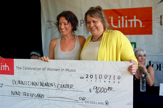 Sarah Mclachlan presents charity cheque to DWC
