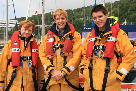 Rupert Grint, Oliver & James Phelps in RNLI Crew Kit