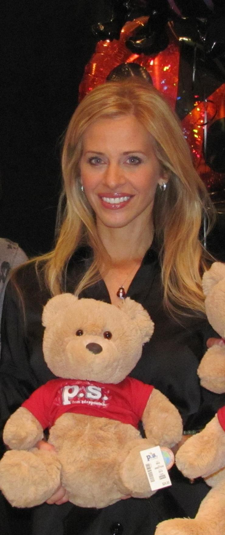 Dina Manzo of The Real Housewives of New Jersey  & Project Ladybug with one of the 386 teddy bears donated by P.S. Aeropostale