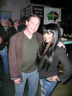 Lil Kim and real estate mogul Billy Procida joined forces at a Grateful Dead-inspired bash on Sunday to raise much-needed funds for the charity Table to Table.
