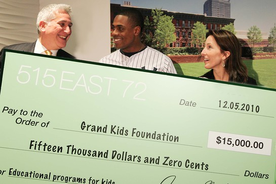 The 515 East 72nd Street team presents Curtis Granderson with the home run charity campaign check.
