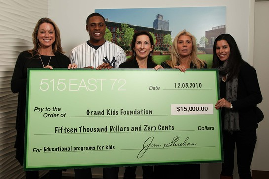 The 515 East 72nd Street sales team gathers with Curtis Granderson after the home run charity campaign check presentation.