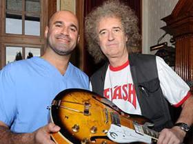 Brian May and Marc Abrahams sign PUP AID Guitar
