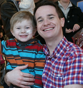 Alex Winters with Caudwell Children beneficiary, William Simpson (5).