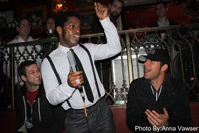Zachary Levi (right) claps to the performance of Vintage Trouble