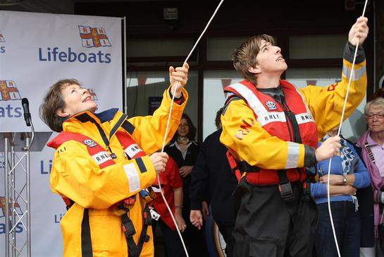Celia Imrie and volunteer crew Max Rimmington raise the appeal flag