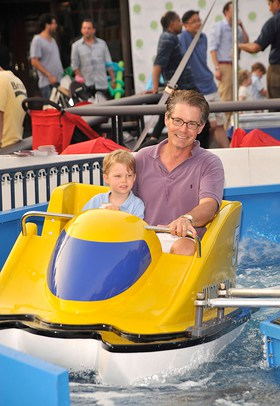 Baby Buggy supporter Kyle MacLachlan enjoying a water ride with his son Callum at the Baby Buggy Bedtime Bash