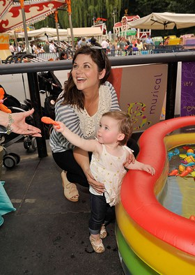 Baby Buggy supporter Tiffani Thiessen playing in the pool with her daughter Harper at the Baby Buggy Bedtime Bash