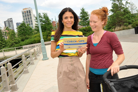 Photo: Bethenny Frankel checks-in walker Stephanie Rhoades' healthy habit at the launch of the Clorox and Children's Health Fund Check-in for Checkups program