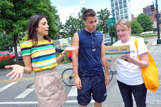 Bethenny Frankel checks-in a runner's healthy habits at the launch of the Clorox and Children's Health Fund Check-in for Checkups program