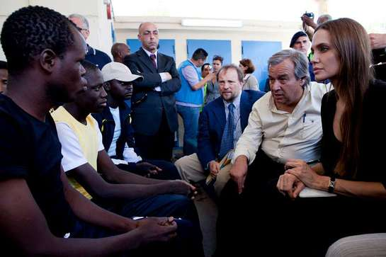 UNHCR chief António Guterres and Goodwill Ambassador Angelina Jolie talk with asylum-seekers on the Italian island of Lampedusa.