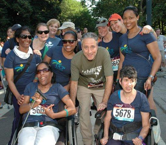 Photo: Jon Stewart POSES WITH TEAM UCP IN CENTRAL PARK AT THE ACHILLES HOPE & POSSIBILITY RACE. (Photos by Lois Silver.)