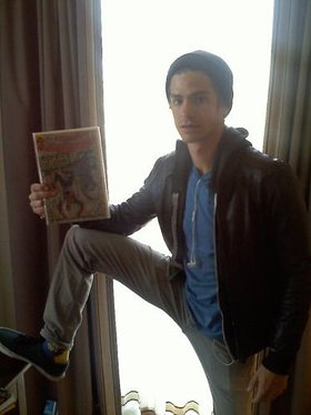 Andrew Garfield with signed Spider-Man comic
