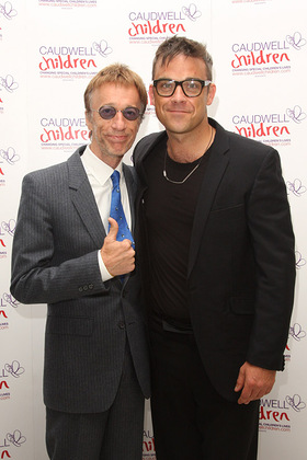 Robin Gibb and Robbie Williams at Caudwell Children Event