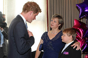 Prince Harry meets Adam Beckett(12), winner of the Most Caring Child Award, with mum Trina - Wednesday 31st of August 2011. .