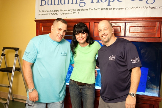 Pauley Perrette flanked by Wayde King (left) and Brett Raymer (right), stars of the Animal Planet series Tanked