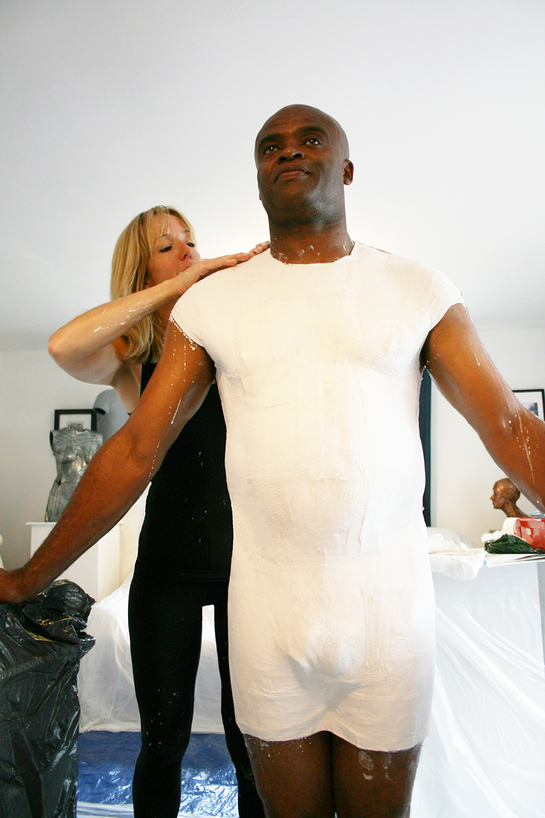 Kriss Akabusi being bodycast