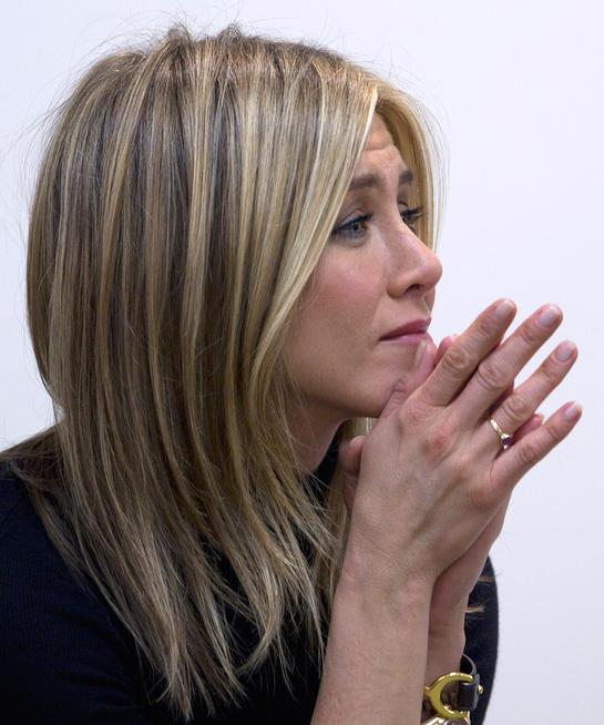Jennifer Aniston, listens to a breast cancer survivor tell her story at the Inova Breast Care Center, Monday, Oct. 3, 2011, in Alexandria,Va. October is breast cancer awareness month. (AP Photo/Carolyn Kaster)