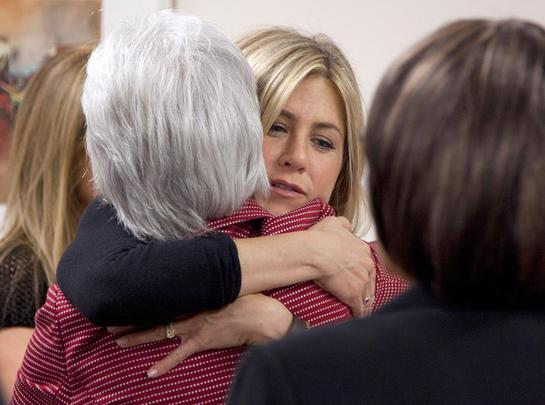 Jennifer Aniston, hugs Health and Human Services Secretary Kathleen Sebelius during an event at the Inova Breast Care Center (AP Photo/Carolyn Kaster)