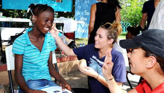 Miley Cyrus joins the Starkey Hearing Foundation in Haiti to bring the gift of hearing to adults and children in need.