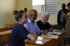 Miley Cyrus with Haitian President Michel Martelly and Bill Austin, Founder of Starkey Hearing Foundation during her second trip to Haiti with the Foundation.
