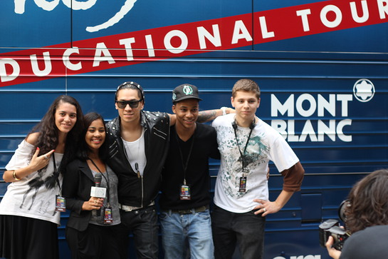 Taboo meets students outside the John Lennon Educational Bus