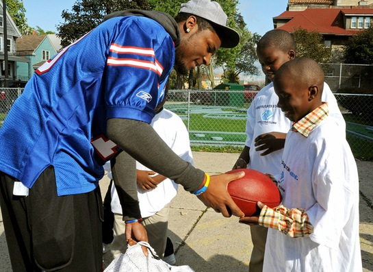 Buffalo Bills star wide receiver Stevie Johnson hands out football gear