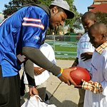 NFL Star Hands Out Football Gear To Kids In Need