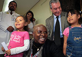 Angelique Kidjo surrounded by children at the Iztapalapa Paediatric Hospital in Mexico City, Mexico.
