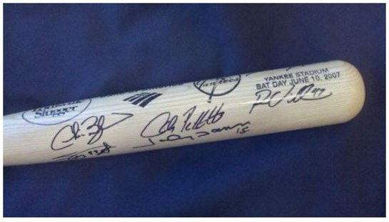 Autographed baseball bat for charity auction